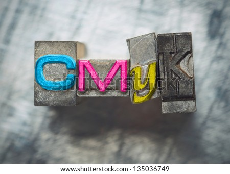 CMYK letters with vintage grunge letterpress type - stock photo