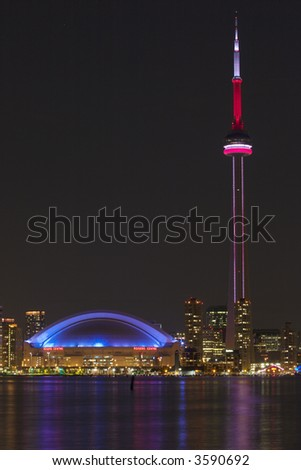 CN Tower and Rogers Centre - stock photo