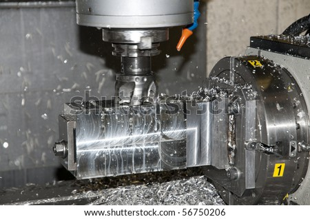 CNC drilling and milling in a workshop that manufactures disks and blades for cutting paper. - stock photo