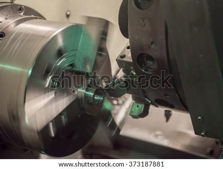 CNC machine at work. - stock photo