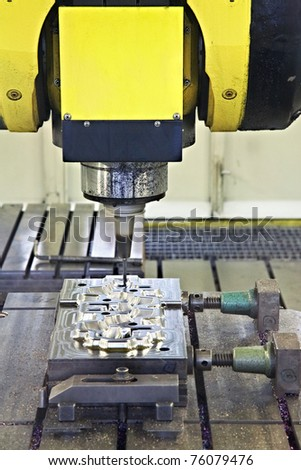 CNC milling cutter in action - stock photo
