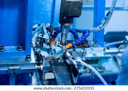 CNC milling machine milling heads in metal industry - stock photo
