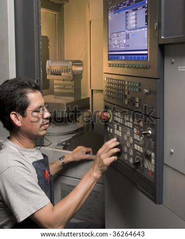 CNC operator at work - stock photo