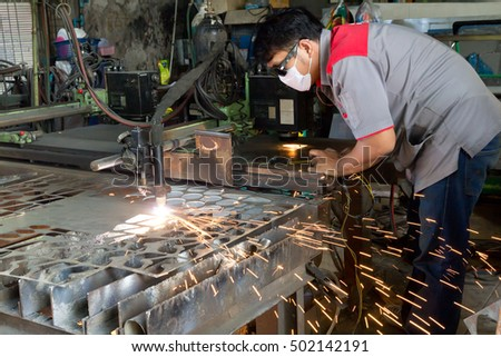 CNC Plasma Cutting Machine During operation. Processing of the steel sheet. Controlled by  Technician
