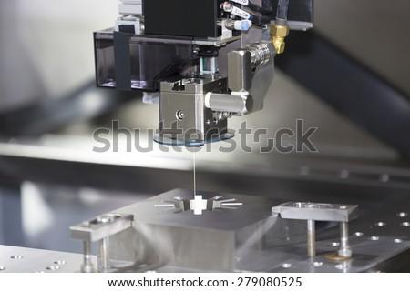 CNC wire cut machine cutting high precision mold parts - stock photo