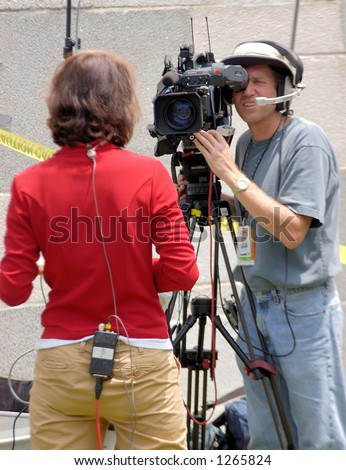 CNN reporter and camera crew at Los Angeles illegal emigrant rally. May 1st 2006 - stock photo