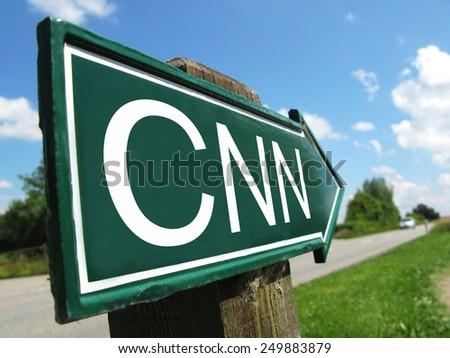 CNN signpost along a rural road - stock photo