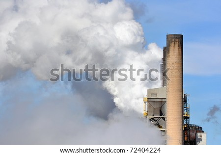 CO2 emissions and industrial smokestacks - stock photo