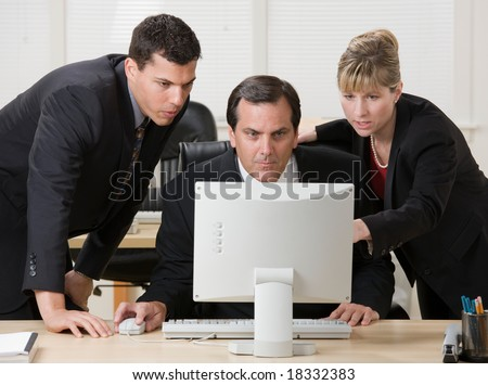 Co-workers collaborating about business problem - stock photo