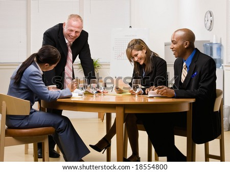 Co-workers having financial meeting in conference room - stock photo