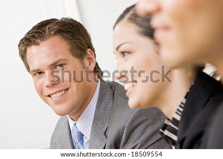 Co-workers in meeting - stock photo