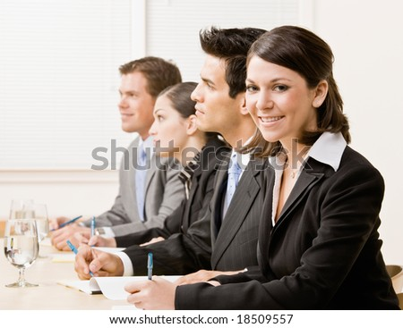 Co-workers in meeting in conference room - stock photo