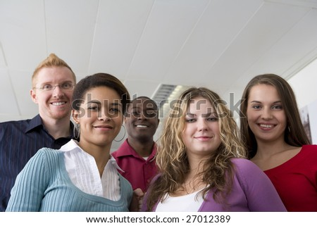 Co-workers posing in office