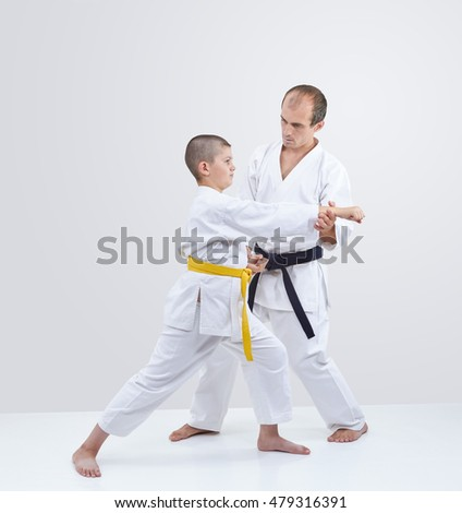 Coach adjusts athlete with yellow belt