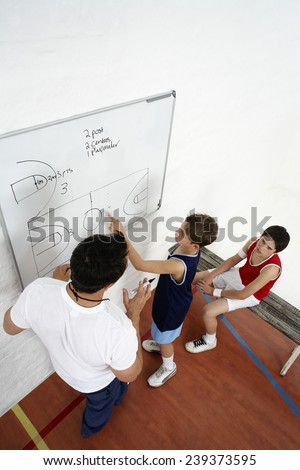 Coach and Team Discussing Strategy - stock photo