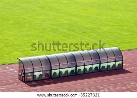 Coach bench near the field - stock photo