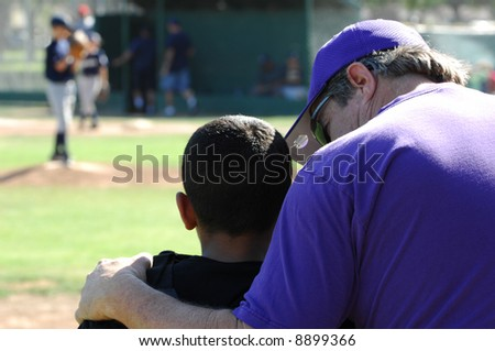 Coach Consoles One of His Players - stock photo