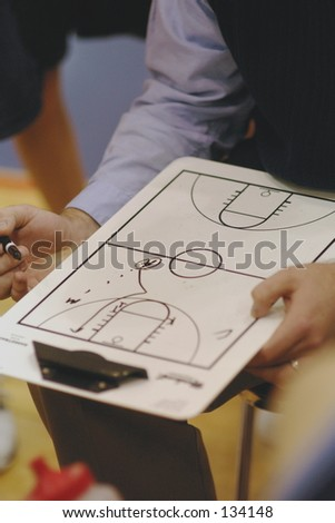 Coach during timeout of basketball game. - stock photo