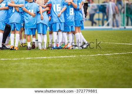 Coach giving children's soccer team instructions. Youth soccer team before final game. Football match for children. shout team, football soccer game - stock photo
