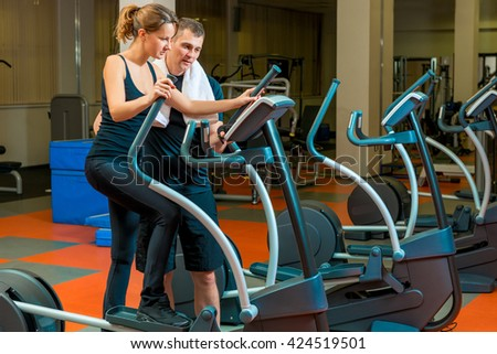 coach teaches an athlete in training in the gym - stock photo