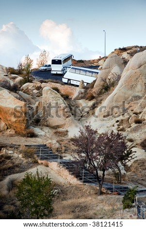 Coach trip in high mountains - stock photo