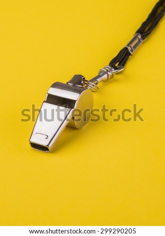 Coaches chrome sports whistle on a rope - stock photo