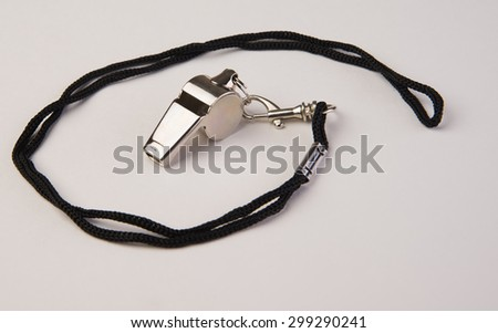 Coaches chrome sports whistle on a rope