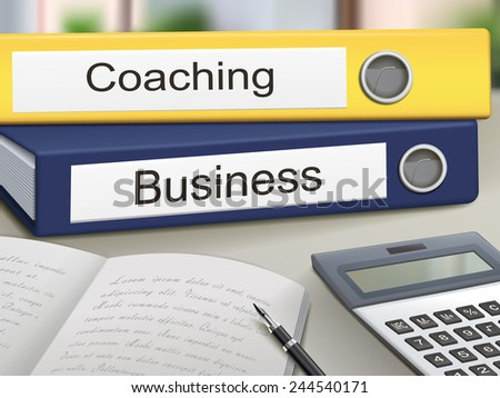 coaching and business binders isolated on the office table - stock photo