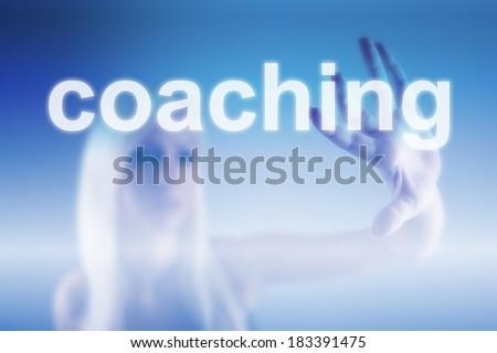 Coaching business concept - woman touching screen - stock photo