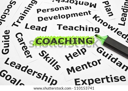 Coaching highlighted with green felt tip pen, with other related words. - stock photo