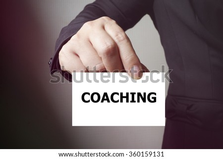 COACHING message on the card , business concept , business idea