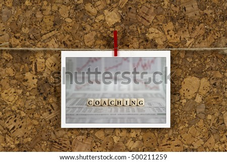 Coaching on business card pinned up on cork board