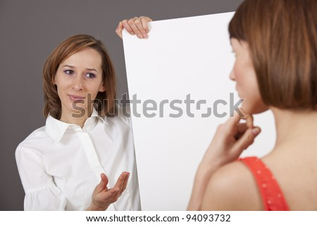 coaching talk - woman holding a blank board talking to a customer - stock photo