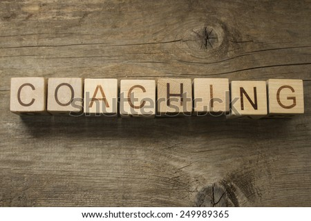 coaching word on a wooden blocks