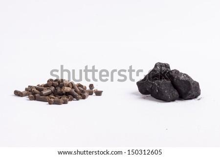 Coal and biomass pellet on white background. - stock photo
