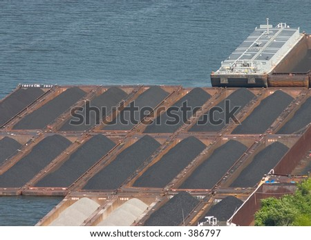 Coal barges at a dock. - stock photo
