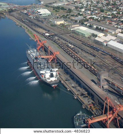 Coal being loaded into a ship at Newcastle Australia - Southern Hemisperes largest coal export port - stock photo