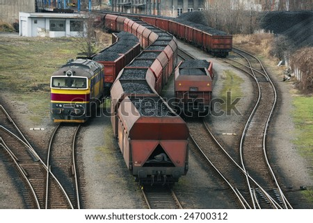 Coal cargo trains - stock photo