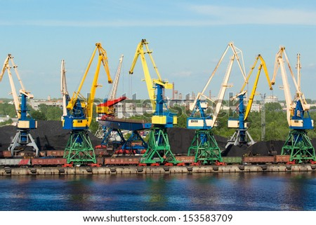 Coal cranes in port - stock photo