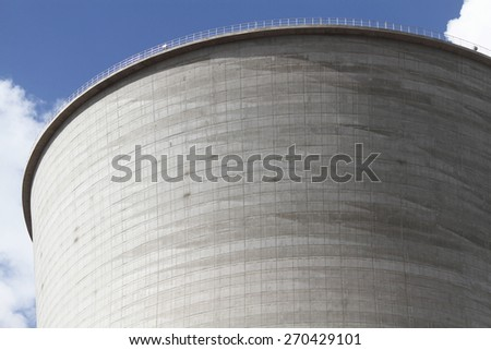 Coal fire power plant concrete cooling tower under construction. - stock photo