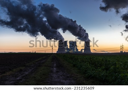 Coal-fired power station at dusk - stock photo