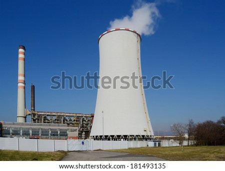 coal fired power station with cooling tower releasing steam into atmosphere - stock photo