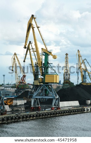 Coal loading in port the harbor crane - stock photo