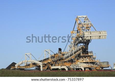 Coal Loading Machinery and Conveyor Belt - stock photo