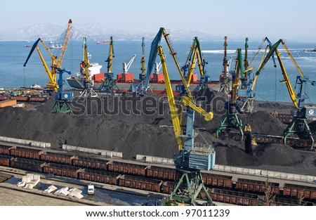 Coal loading on a vessel in port Nakhodka (Far East) - stock photo