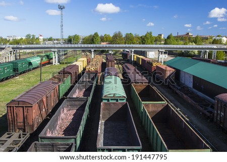 Coal , metal, iron square tube is transported in railway train marshaling yard - stock photo