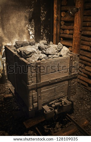 Coal mine cart full of coal - stock photo