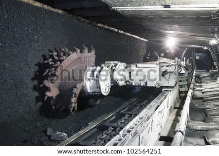 Coal mine excavator underground - stock photo