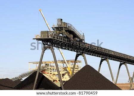Coal Mining Conveyor Belt and piles of coal. Australia - stock photo