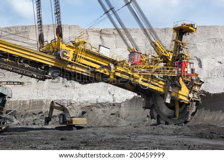 Coal mining in open-cast mine - stock photo